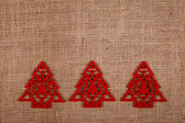Christmas ornament on burlap — Stock Photo