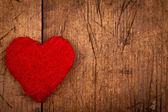 String red heart on wooden background — Stock Photo