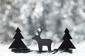 Trees and a reindeer — Stock Photo