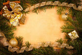 Golden Christmas decoration on old paper — Stock Photo