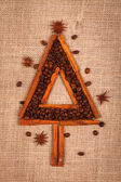 Christmas tree of coffee beans and cinnamon — Stock Photo