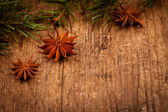 Star anise and branch on wooden background — Stock Photo