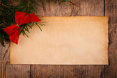 Wooden background with Christmas ornaments and old paper — Foto de Stock