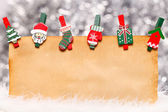 Old paper with Christmas ornaments — Stock Photo