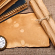 Old pocket watch with rolls and books — Stock Photo