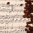 Musical background with coffee beans — Stock Photo