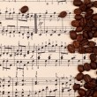 Musical background with coffee beans — Stock Photo #37204413