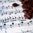 Musical score with coffee beans on it — Stock Photo