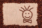 Happy face made of coffee beans — Stock Photo