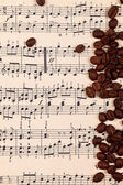 Musical background with coffee beans — Stockfoto
