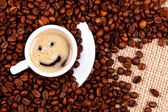 Cup of coffee with smiley face — Stock Photo