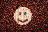 Smiley face of coffee — Stock Photo