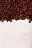 Coffee beans as border on white — Stock Photo