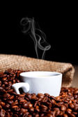 Cup of steamy coffee — Stock Photo