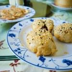 Fried dumplings served on white plate — Stock Photo