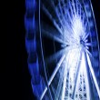 Ferris wheel in motion in a night time — Stock Photo #19654591