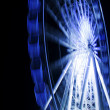 Ferris wheel in motion in a night time — Stock Photo
