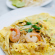 Fried noodle wrapped with eggs, Thai style food - Stock Photo