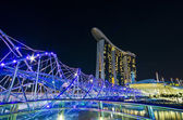 SINGAPORE - JUNE 27: The Marina Bay Sands resort and Helix Bridg — Stock Photo