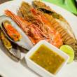 Set of Grilled Seafood with spicy sauce — Stock Photo #30309439