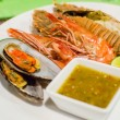 Set of Grilled Seafood with spicy sauce — Stock Photo #30309451