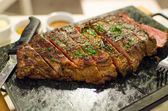 Grilled beef medium steak with parsley — Stock Photo
