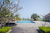 Swimming pool in tropical style resort — Stock Photo