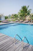 Swimming pool in tropical style resort — Stok fotoğraf