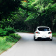 Speed drive following white car on the road — Stock Photo #4043482