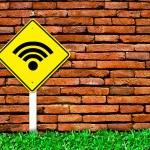 Wi-fi internet symbol on brick wall — Stock Photo #4942123