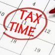 Tax time sign written with pen on calendar — Stock Photo #18437191