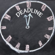 Stock Photo: Deadline clock sign