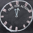 Foto Stock: Time for action clock sign