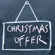 Christmas offer board drawn with chalk on blackboard — Stock Photo #22597685