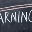 Increase earnings sign drawn with chalk on blackboard — Stock Photo