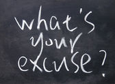 What is your excuse title written with chalk on blackboard — Stock Photo