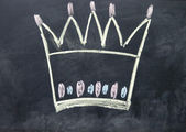 Crown sign drawn with chalk on blackboard — Stock Photo