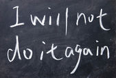 I will not do it again title written with chalk on blackboard — Stock Photo