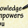 Knowledge empowers you title written with pen on paper — 图库照片