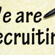 We are recruiting title written with pen on paper — Stock Photo
