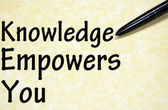 Knowledge empowers you title written with pen on paper — Stockfoto