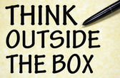 Think outside the box title written with pen on paper — Stock Photo