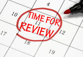 Time for review sign written with pen on paper — Stock Photo