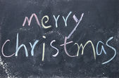 Merry christmas title written with chalk on blackboard — Stock Photo