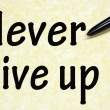 Never give up title written with pen on paper — Stock Photo #23946617