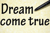 Dream come true title written with pen on paper — Stock Photo