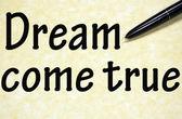 Dream come true title written with pen on paper — Stock Photo