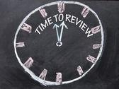 Tid att granska klocka tecken — Stockfoto