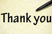 Thank you title written with pen on paper — Stock Photo