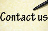 Contact us title written with pen on paper — Zdjęcie stockowe
